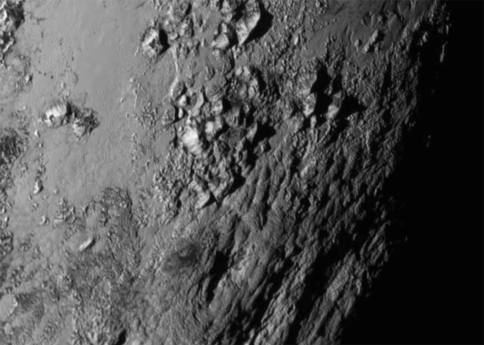 New close-up images of a region near Pluto's equator reveal a giant surprise: a range of youthful mountains. [NASA]