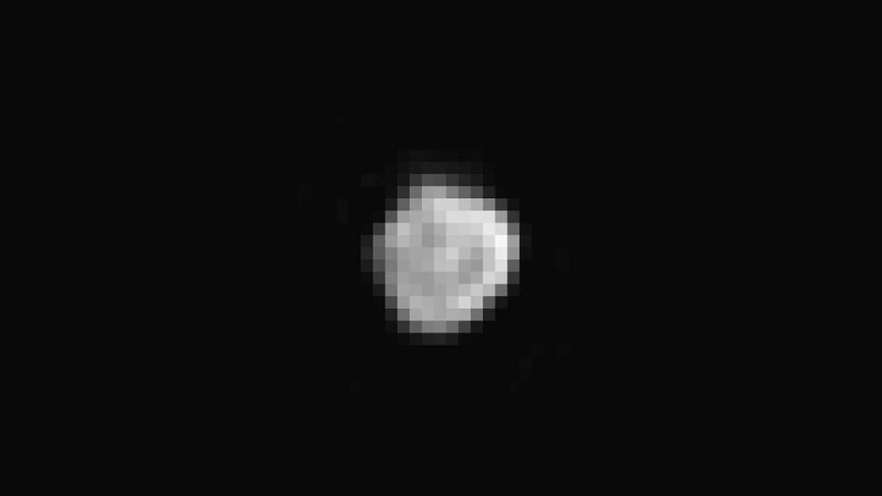 Homing in on Pluto's small satellite Nix, New Horizons' Long Range Reconnaissance Imager captured this image, which shows features as small as 4 miles (6 kilometers across). Mission scientists believe we are looking at one end of an elongated body about 25 miles (40 kilometers) in diameter.