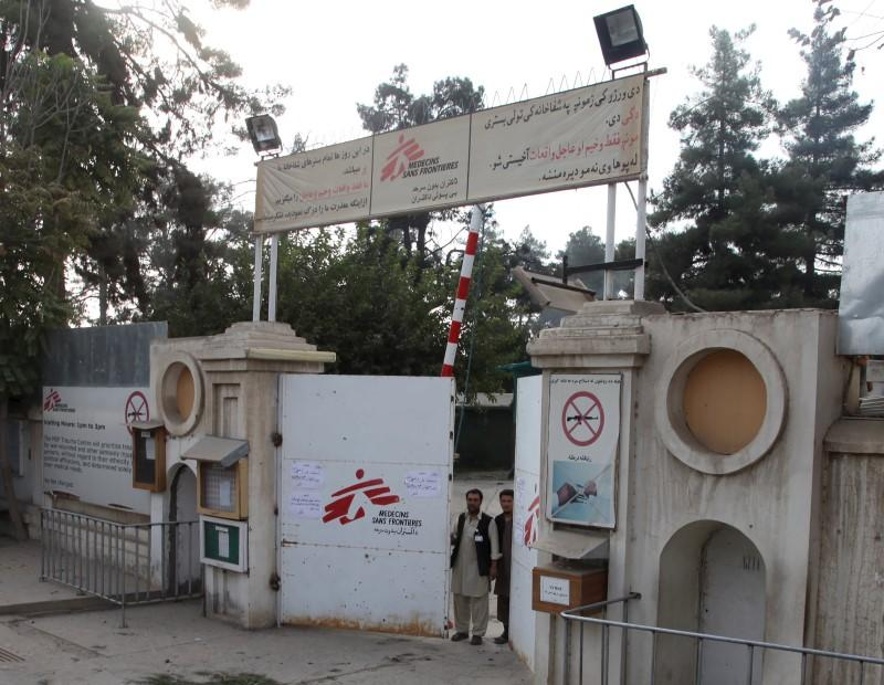Afghan guards stand at the gate of MSF hospital after an air strike in the city of Kunduz. REUTERS