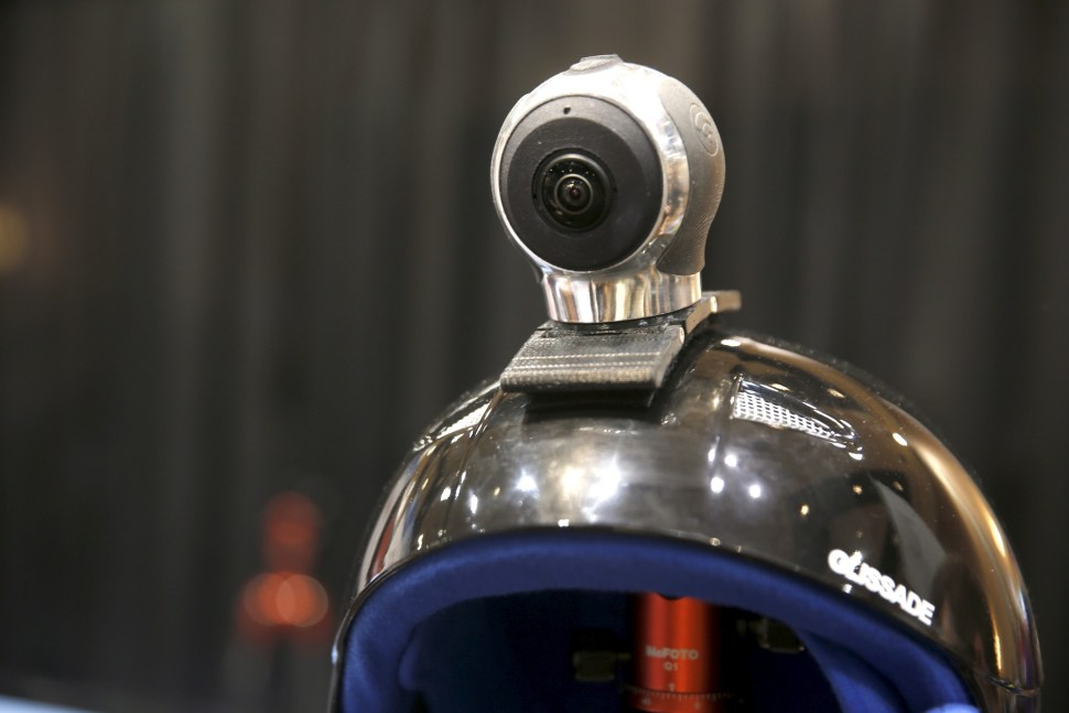 An Allie Go, a 360-degree action cam, by IC Real Tech is shown on a helmet. The $599.00 camera uses two sensors with over 180 degree-coverage each and combines the video in the unit using Qualcomm processors.  REUTERS