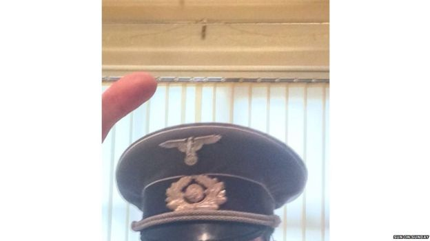 Nazi uniform item that appears in the priest's cocaine tape