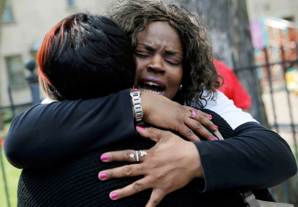 """Nortasha Stingiey (R) hugs Lutrice Boyd at a """"Purpose over Pain"""" gathering. The group of mothers who lost children to gun violence are calling for a stop to shootings in Chicago. May 6, 2016. REUTERS/Jim Young"""