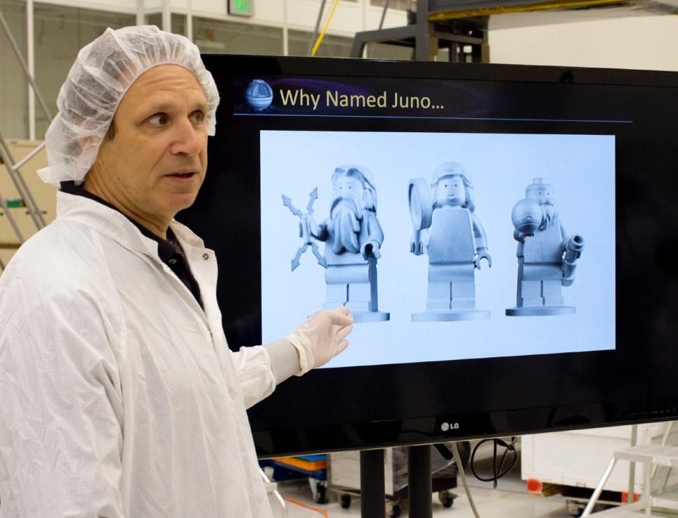 Scott Bolton (Juno mission principal investigator) and the Lego figurine passengers. [Photo: Katherine Leipper]