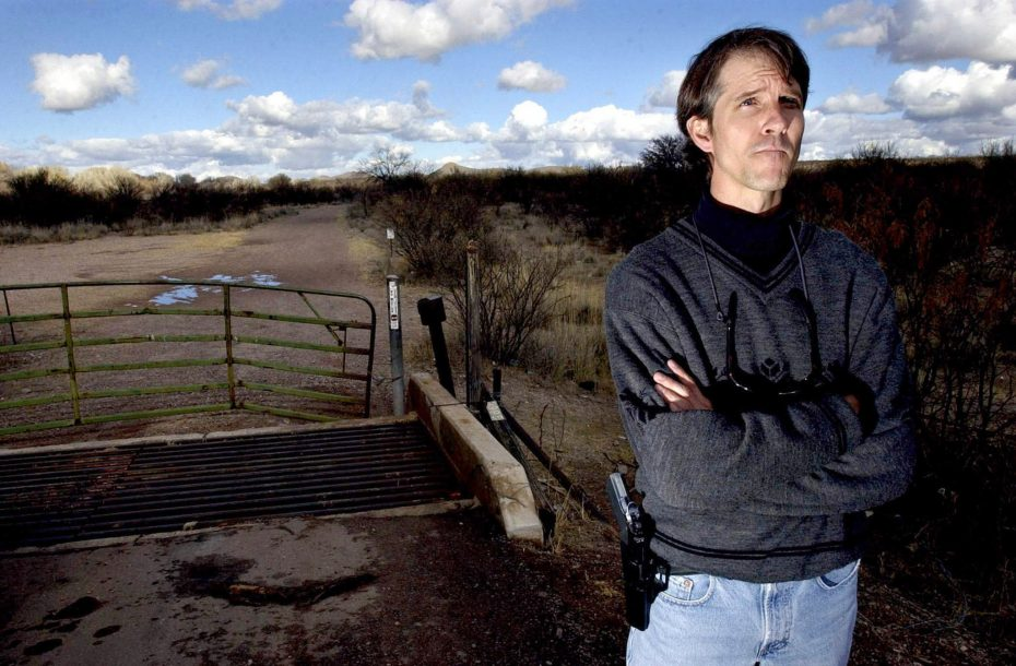 Chris Simcox, when he was leader of the Civil Homeland Defense and publisher of the Tombstone Tumbleweed in Tombstone, Arizona.  He patrolled an area 5 miles north of the the Mexico U.S. border with his .45 cal semi-auto handgun on his hip in this 2002 file photo. REUTERS