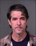 Simcox's 2013 booking mugshot