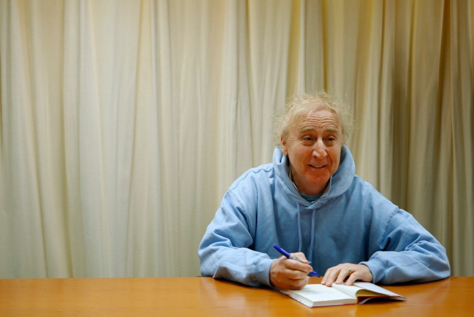 Actor and author Wilder poses as he autographs his book 'The Woman Who Wouldn't' during a 2008 book signing session in New York. [Reuters]