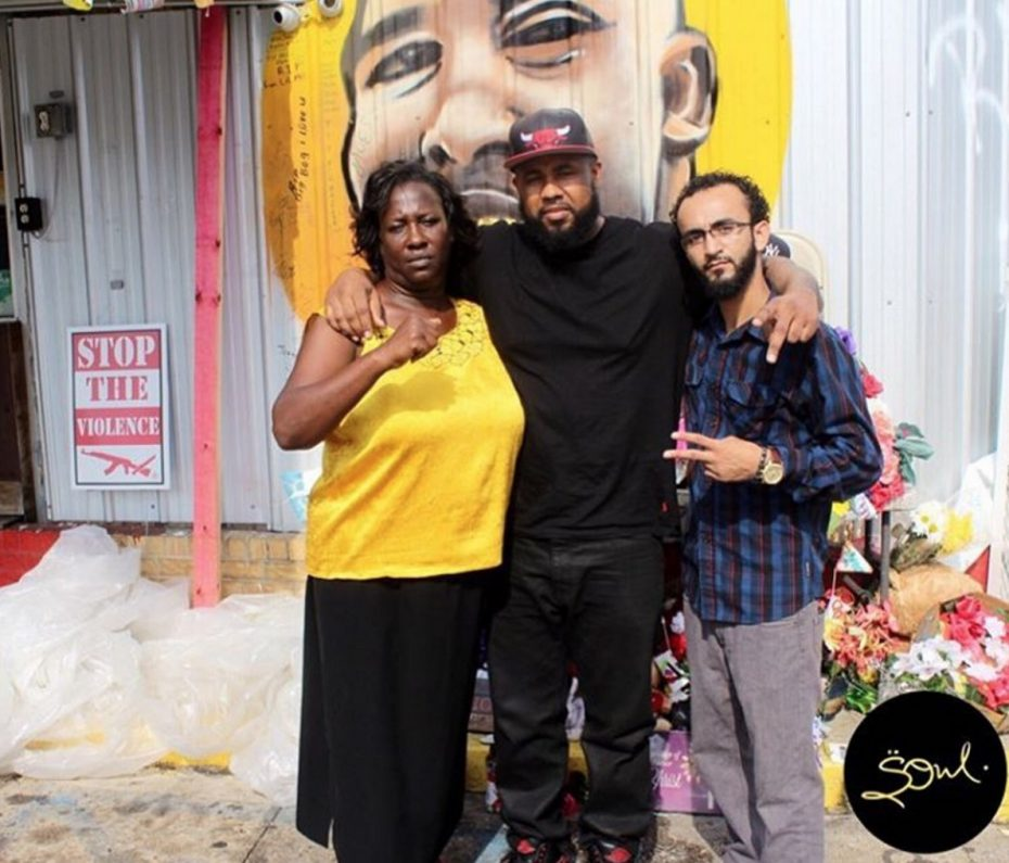​​ Alton Sterling's aunt Veda Washington, Chris LeDay and Abdullah Muflahi, in front of a memorial to Sterling. LeDay uploaded a video of the police shooting and was arrested 26 hours later. Muflahi documented the police shooting of Alton Sterling and was arrested immediately afterwards.