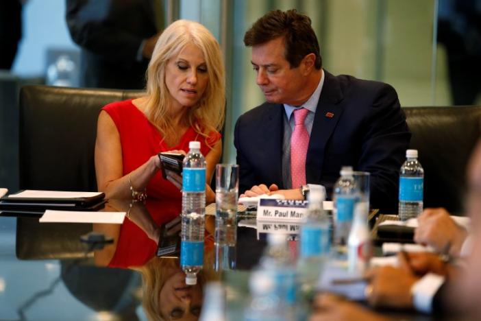 Campaign Manager Kellyanne Conway (L) and Paul Manafort, staff of Republican presidential nominee Donald Trump, speak during a round table discussion on security at Trump Tower New York, U.S., August 17, 2016. REUTERS/Carlo Allegri