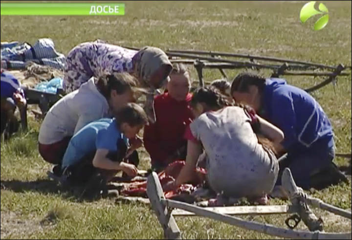 The anthrax outbreak killed a 12-year-old boy who ate infected reindeer meat, and drank blood from the animal. Archive photo: A family in the Nenets area of Northern Siberia eating fresh venison in the tundra region.