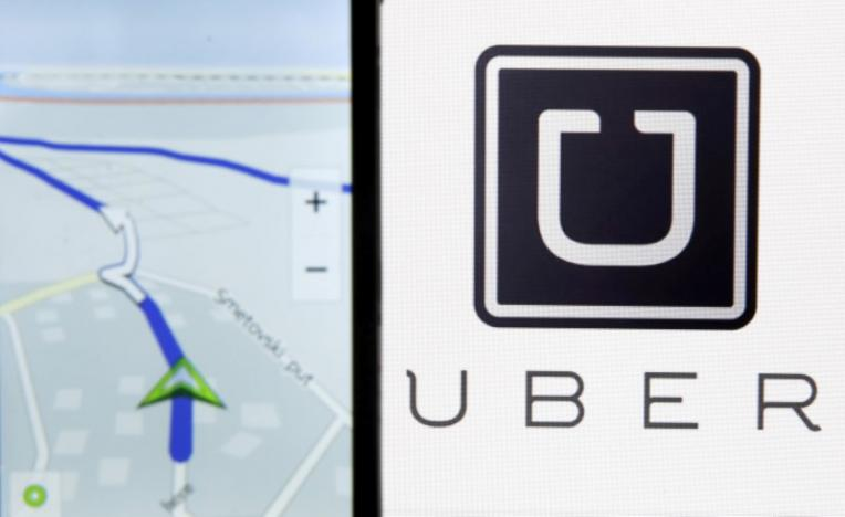 Nokia Maps is seen on a smartphone in front of a displayed logo of Uber in this May 8, 2015 photo illustration.  REUTERS