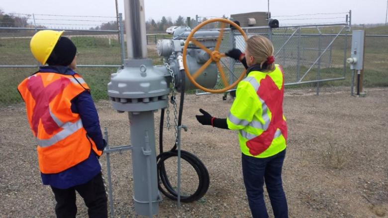 Activists attempt to shutdown oil pipeline valve after cutting chains at a valve station for pipelines carrying crude from Canadian oils sands into the U.S. markets near Clearbrook, Minnesota, U.S., in this image released by Climate Direct Action on October 11, 2016.