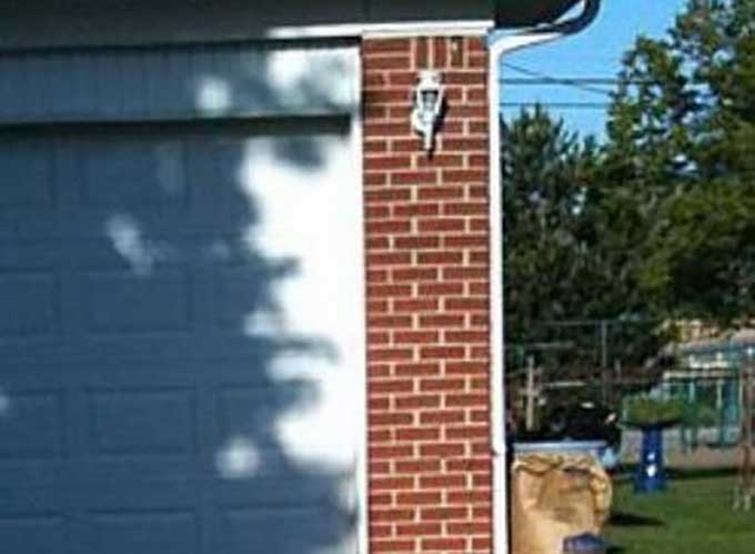 Shadow on garage door looks like human face  Boing Boing
