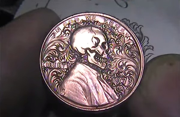 Watch this engraver reshape Abe Lincoln's penny portrait into a skull