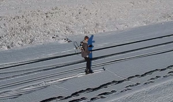 Watch this guy make and use a propeller backpack for skiing