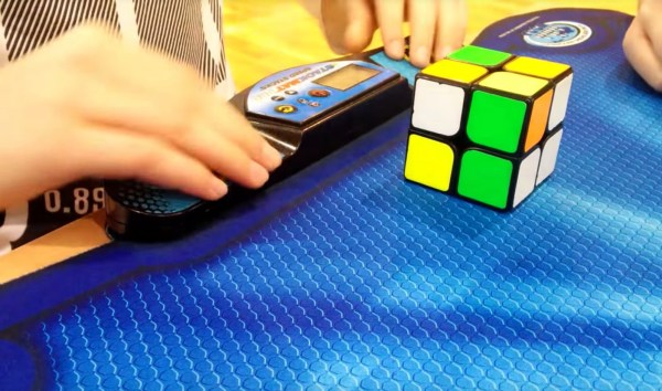 Watch this guy solve a 2x2x2 Rubik's Cube in under half a