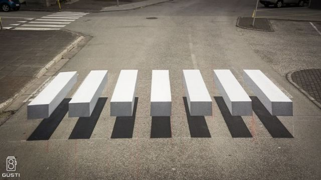 Painting freaky illusions on the road as virtual speed bumps