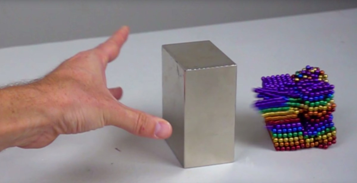 Watch what happens when a big neodymium magnet collides with 1,000 small ones