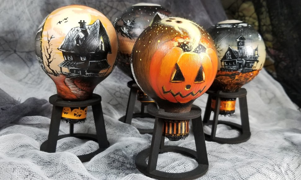 Spooky Halloween ornaments painted on outsized lightbulbs