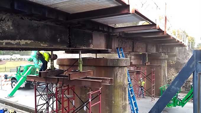 Watch how the 11foot8 bridge is being raised by 8 inches
