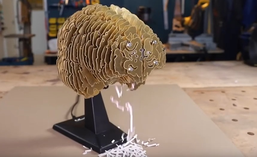 Simone Giertz makes a paper shredder from her own brain scan