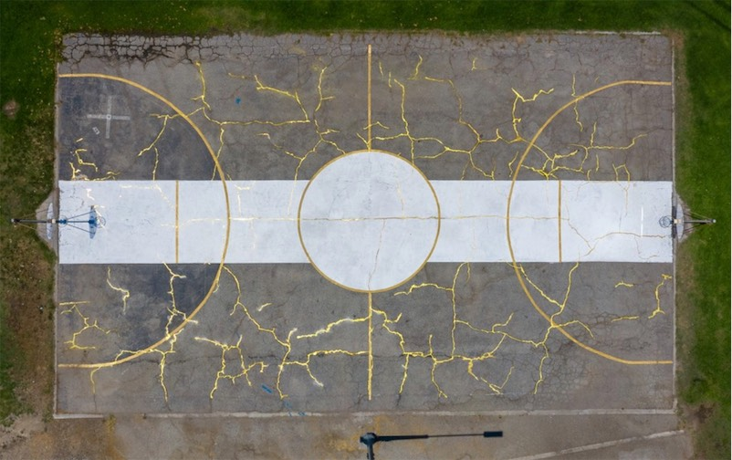 Repairing a decaying basketball court with the Japanese art of kintsugi