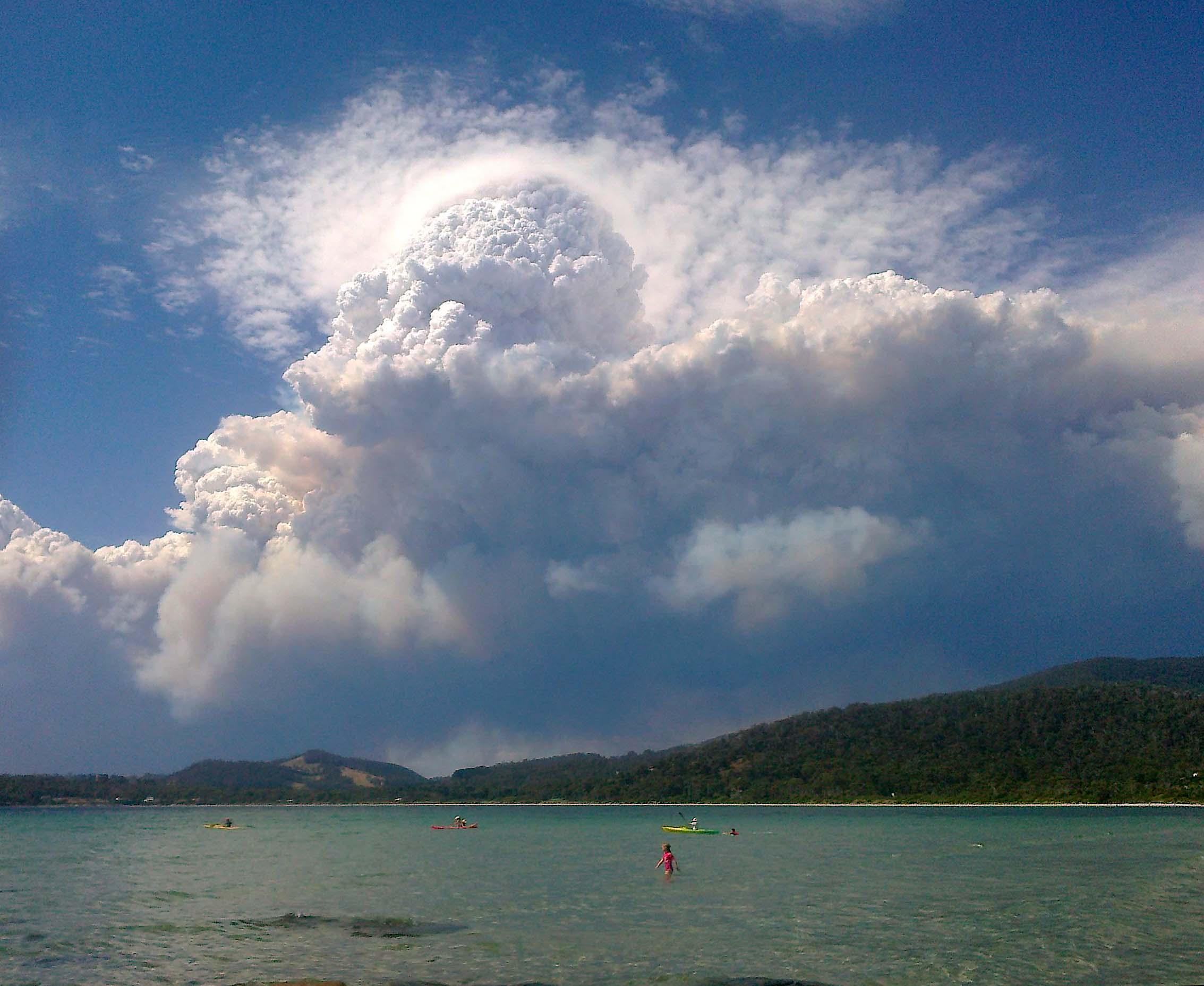 Image: Pyrocumulonimbus cloud forms above a bushfire in Tasmania, 2013. Credit: Janice James