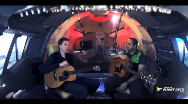 """Halifax musician Asif Illyas (right) hosts the online talk show """"Live On The Flight Deck"""" in a home-built flight simulator. Here he is shown interviewing musician Joel Plaskett (left). THE CANADIAN PRESS/HO-Asif Illyas MANDATORY CREDIT"""