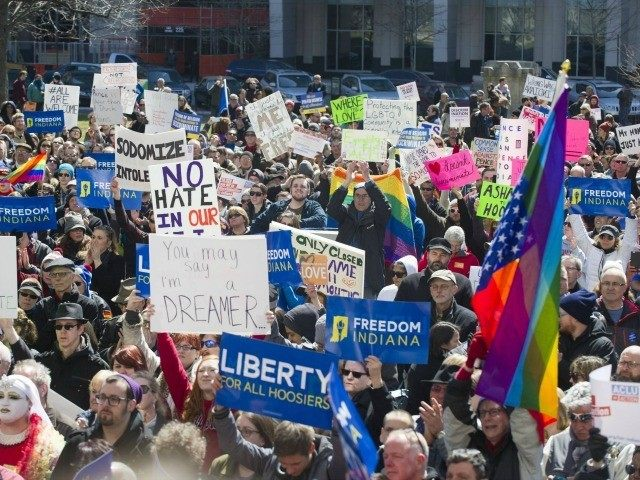 https://i0.wp.com/media.breitbart.com/media/2015/04/indiana-rfra-protest-flag-AP-640x480.jpg