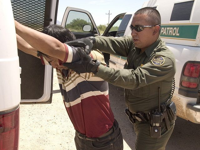 CBP Border Patrol agent does a pat down of a Mexican being returned to Mexico.