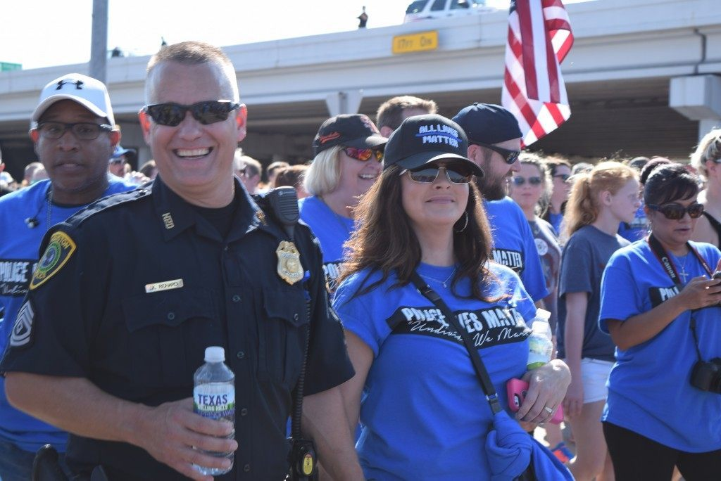 Houston Police Sergeant J.K. Richard joins in the family oriented march for #PoliceLivesMatter. (Photo: Breitbart Texas/Bob Price)