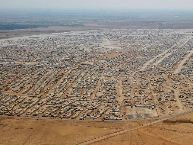 An aerial view shows the Zaatari refugee camp, near the Jordanian city of Mafraq July 18, 2013. U.S. Secretary of State John Kerry spent about 40 minutes with half a dozen refugees who vented their frustration at the international community's failure to end Syria's more than two-year-old civil war, while visiting the camp that holds roughly 115,000 Syrian refugees in Jordan about 12 km (eight miles) from the Syrian border. REUTERS/Mandel Ngan/Pool