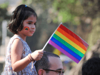 Caption:A girl looks on during the 'Queer Azadi March' freedom march for lesbian, gay, bisexual and transgender supporters, in Mumbai on January 29, 2011. In July 2009, Delhi High Court decriminalised gay sex between consenting adults by declaring a colonial-era ban on homosexuality unconstitutional. AFP PHOTO Sajjad HUSSAIN (Photo credit should read SAJJAD HUSSAIN/AFP/Getty Images)