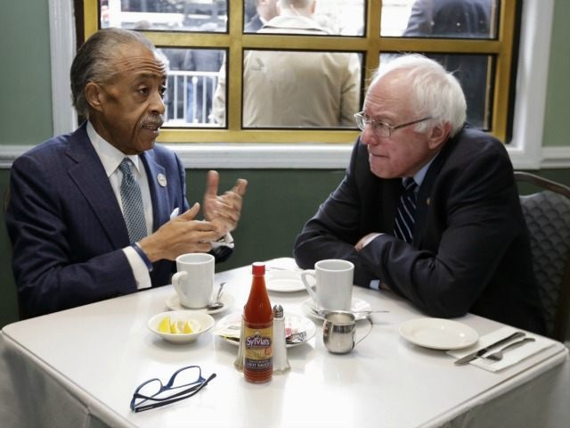 The Rev. Al Sharpton, left, talks with Democratic presidential candidate Sen. Bernie Sanders, I-Vt. as they sit down for a breakfast meeting at Sylvia's Restaurant, Wednesday, Feb. 10, 2016, in the Harlem neighborhood of New York. Sanders defeated former Secretary of State Hillary Clinton on Tuesday in the New Hampshire primary. (