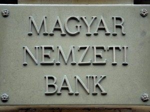 BUDAPEST, HUNGARY: A sign for the Hungarian National Bank hangs on the wall of the bank's headquarters in Budapest, 22 October 2004. A long-standing feud between the government and the central bank heated up in Hungary with a proposed legislation that would give the government influence in determining monetary policy, which the bank charges would violate its independence. AFP PHOTO / ATTILA KISBENEDEK (Photo credit should read ATTILA KISBENEDEK/AFP/Getty Images)