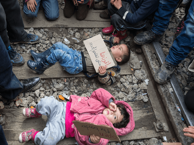 Migrant children train track Greece