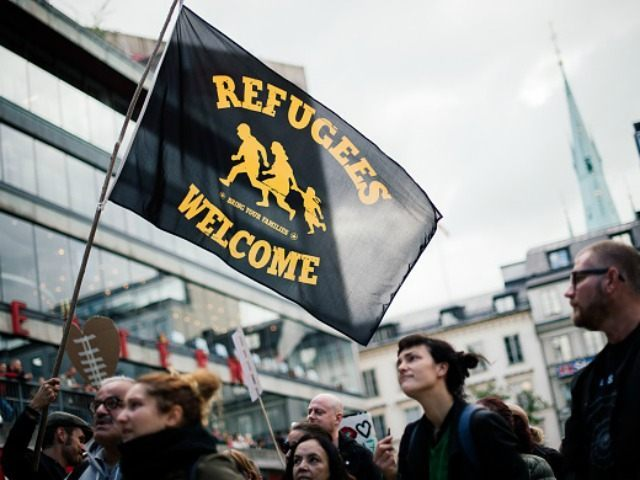People take part in a demonstration in solidarity with migrants in Stockholm on September 12, 2015.)