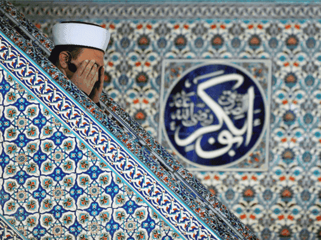 A muslim imam prays in the mosque in downtown Sofia on April 5, 2013. Bulgaria is hoping to stop protest-driven suicides, including self-immolations, that have swept the country in recent weeks by organising prayers for all faiths and free psychological counselling.