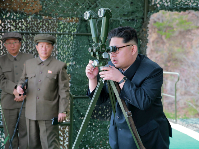 """DEMOCRATIC PEOPLE'S REPUBLIC OF KOREA : This picture released from North Korea's official Korean Central News Agency (KCNA) on April 24, 2016 shows North Korean leader Kim Jong-Un (R) inspecting an underwater test-fire of a strategic submarine ballistic missile at an undisclosed location in North Korea on April 23, 2016. North Korean leader Kim Jong-Un hailed a submarine-launched ballistic missile (SLBM) test as an """"eye-opening success"""", state media said on April 24, declaring Pyongyang has the ability to strike Seoul and the US whenever it pleases. / AFP PHOTO / KCNA VIA KNS / KCNA"""