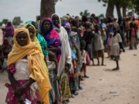 Women and children wait on June 30, 2016, to visit one of the UNICEF nutrition clinics, on the outskirts of Maiduguri, capital of Borno State, an area that has been torn apart for the last seven years by Boko Haram insurgents