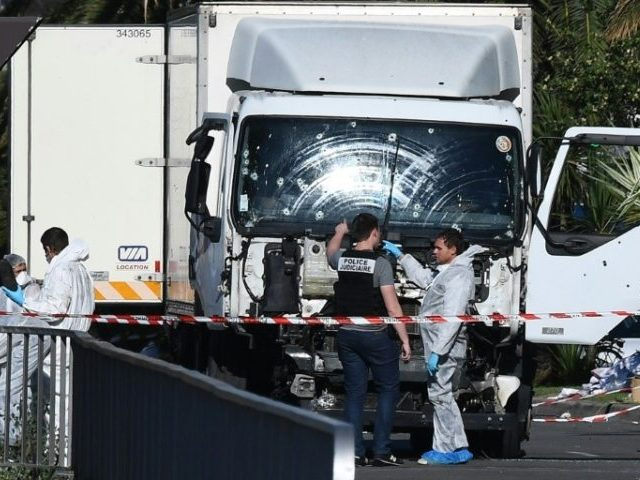 French forensic officers look for evidence near a truck which ploughed through a crowd celebrating Bastille Day in Nice, on July 15, 2016