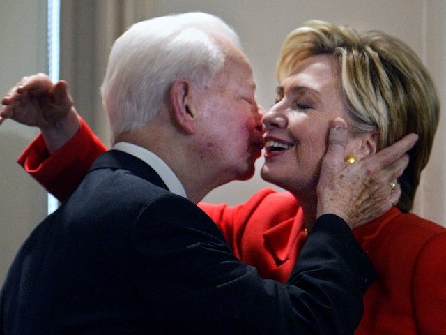 """FILE - In this July 26, 2004 file photo, Sen. Hillary Clinton, D-NY, is embraced by Sen. Robert Byrd, D-W.Va., at a bookstore in New York where they were launching his book """"Losing America: Confronting a Reckless and Arrogant Presidency."""" Just hours before she was to speak at the Democratic National Convention in Boston, Clinton introduced Byrd as her mentor and told the audience that he has been a champion of the U.S. Constitution.  Byrd a fiery orator versed in the classics and a hard-charging power broker who steered billions of federal dollars to the state of his Depression-era upbringing, died Monday, June 28, 2010.   (AP Photo/Bebeto Matthews, File)"""