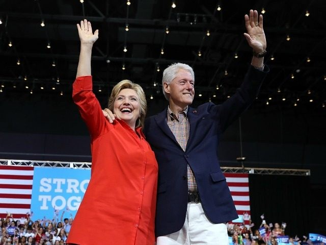 Democratic presidential nominee former Secretary of State Hillary Clinton and her husband former U.S. president Bill Clinton greet supporters during a campaign rally with democratic vice presidential nominee U.S. Sen Tim Kaine (D-VA) at the David L. Lawrence Convention Center on July 30, 2016 in Pittsburgh, Pennsylvania. Hillary Clinton and Tim Kaine are continuing their three-day bus tour through Pennsylvania and Ohio. (Photo by