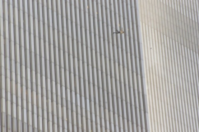 A man jumps from the north tower of New York's World Trade Center Tuesday, Sept. 11, 2001 after terrorists crashed two hijacked airliners into the World Trade Center. (AP Photo/Richard Drew)
