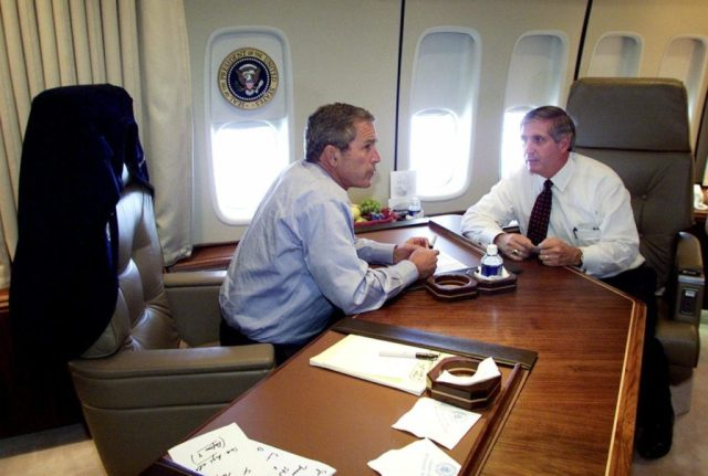 President Bush talks with Chief of Staff Andrew Card aboard Air Force One during a flight to Offutt Air Force Base in Omaha, Neb., following the presidents' statement about the terrorist attack on the World Trade Center in New York City, Tuesday, Sept. 11, 2001. (AP Photo/Doug Mills)