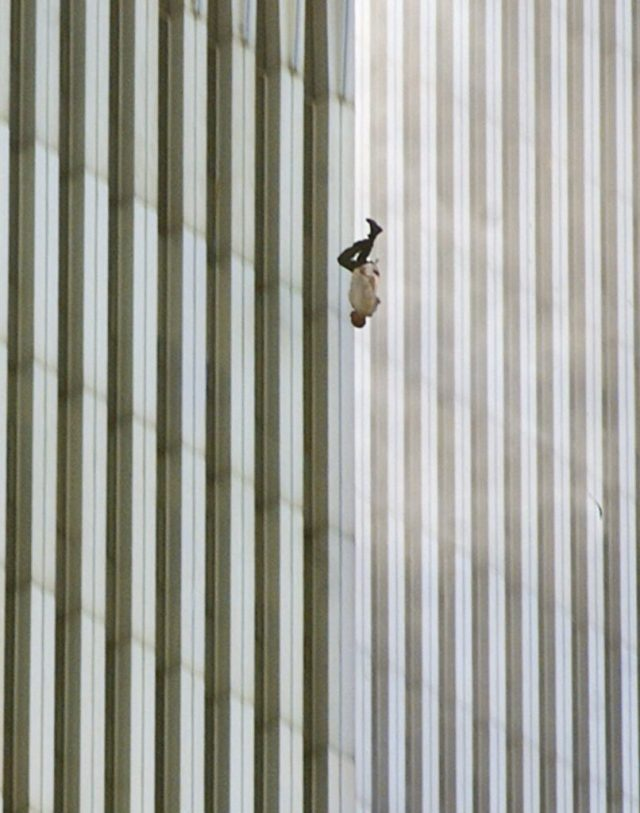 EDITORS: NOTE GRAPHIC CONTENT--- A person falls headfirst from the north tower of New York's World Trade Center Tuesday, Sept. 11, 2001. (AP Photo/Richard Drew)