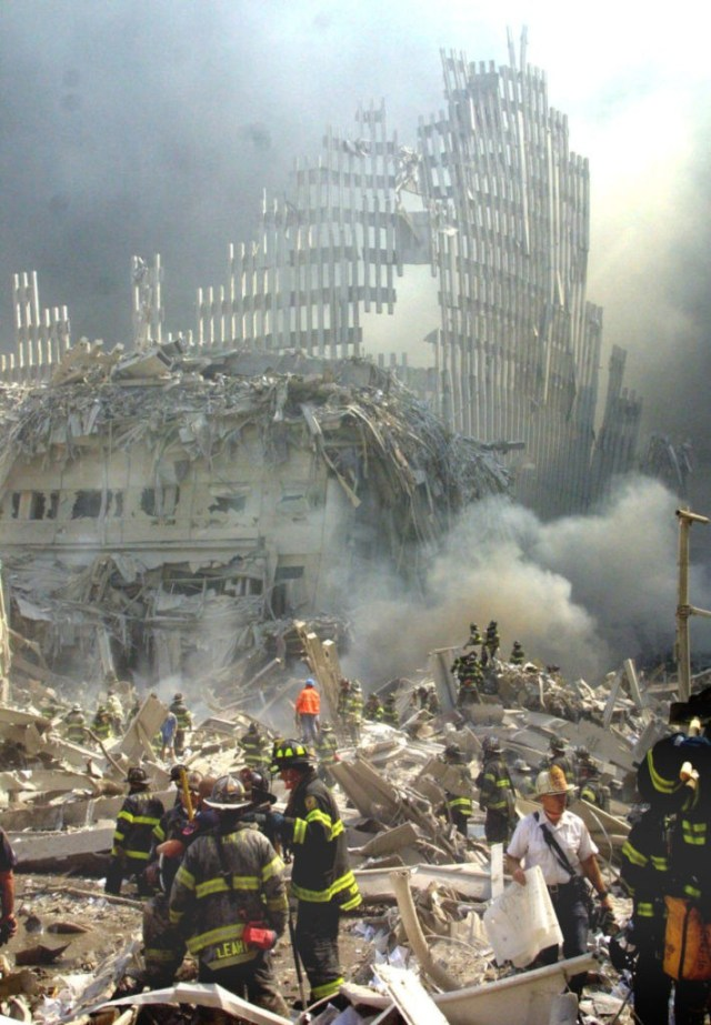 A shell of what was once part of the facade of one of the twin towers of New York's World Trade Center rises above the rubble that remains after both towers were destroyed in a terrorist attack Tuesday, Sept. 11, 2001. The 110-story towers collapsed after two hijacked airliners carrying scores of passengers slammed into the sides of the twin symbols of American capitalism. (AP Photo/Shawn Baldwin)