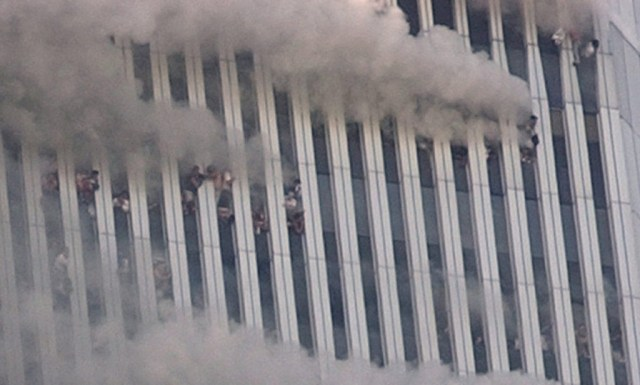 ** FILE ** People hang out of broken windows of the North Tower of the World Trade Center after a terrorist attack in New York on the morning of Sept. 11, 2001. Richard Pecorella has spent years searching for an image he says will bring him peace: a photograph that proves his fiancee, whom he believes could be in this photo, jumped to her death from the burning World Trade Center. (AP Photo/Amy Sancetta, File)