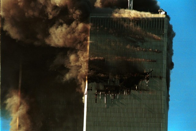 394261 109: Smoke pours from the World Trade Center after it was hit by two planes September 11, 2001 in New York City. (Photo by Robert Giroux/Getty Images)