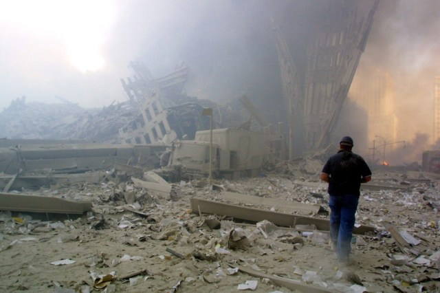 NEW YORK, UNITED STATES: A man walks through the rubble after the collapse of the first World Trade Center Tower 11 September, 2001 in New York. AFP PHOTO Doug KANTER (Photo credit should read DOUG KANTER/AFP/Getty Images)