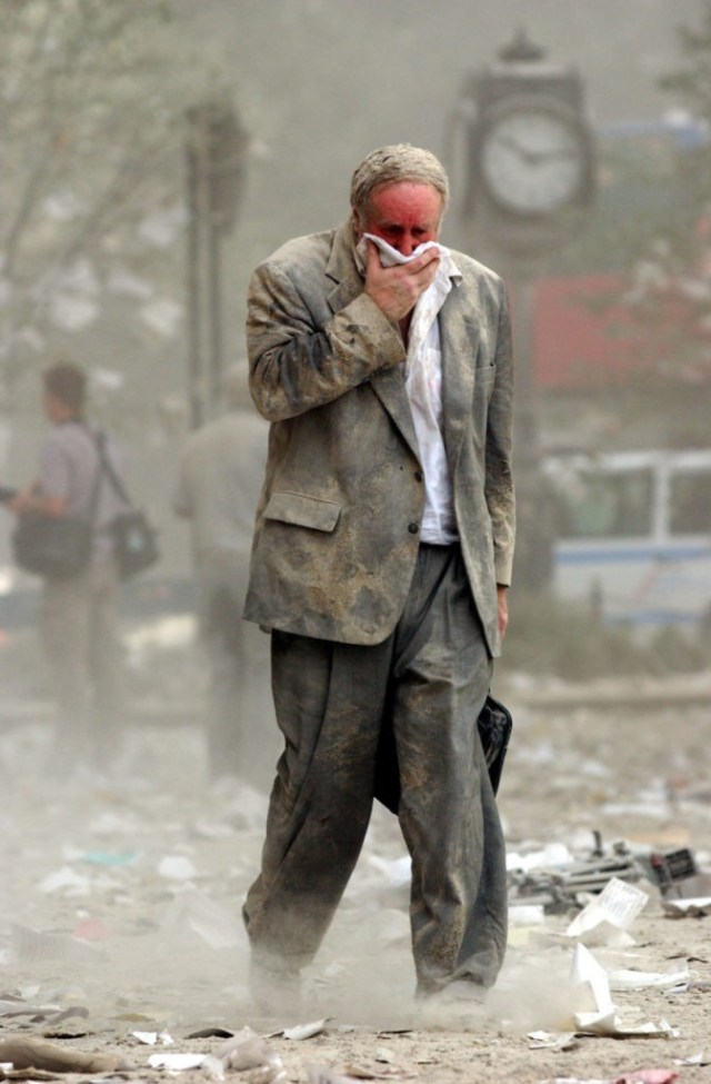 NEW YORK, UNITED STATES: US-WTC-THEN AND NOW-ED FINE 1(FILES) This file photo dated 11 September 2001 shows Edward Fine covering his mouth as he walks through the debris after the collapse of one of the World Trade Center Towers in New York. Fine was on the 78th floor of 1 World Trade Center when it was hit by a hijacked plane 11 September. AFP PHOTO/Stan HONDA (Photo credit should read STAN HONDA/AFP/Getty Images)